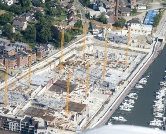 8 żurawi WOLFF buduje modną dzielnicę mieszkaniową i handlową na Błękitnym Bulwarze w Limburgu